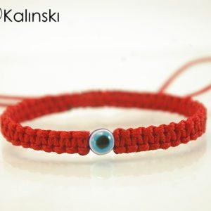 Червена гривна против уроки със синьо оче
